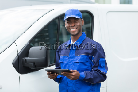 young african delivery man holding digital