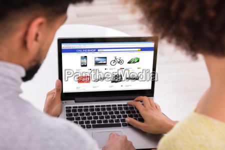 couple using laptop for shopping online