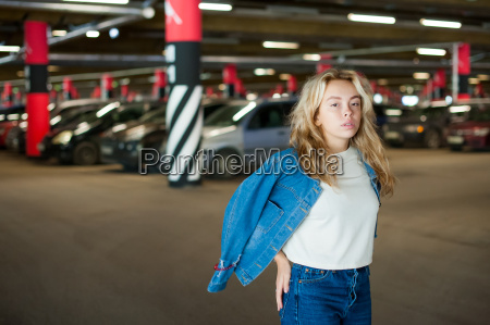 young beautiful woman in jeans clothes