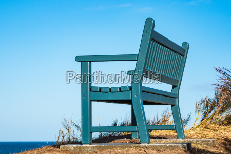 a bench on the coast of