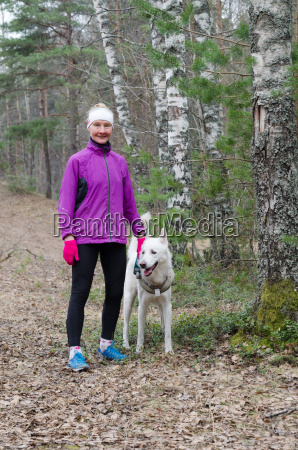 sporty woman with a dog in