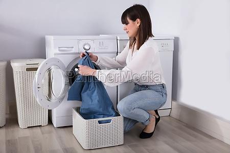 young woman looking at t shirt