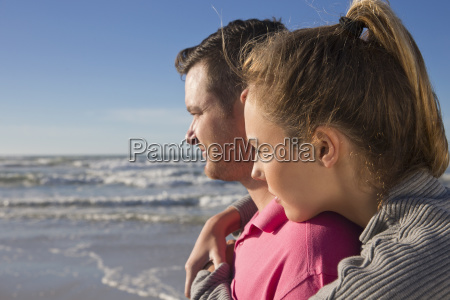 romantic couple looking out to sea