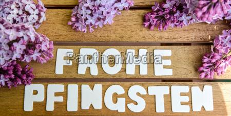 happy pentecost words on a holtbrett