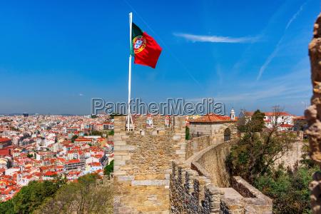 portuguese flag on fortress wall lisbon