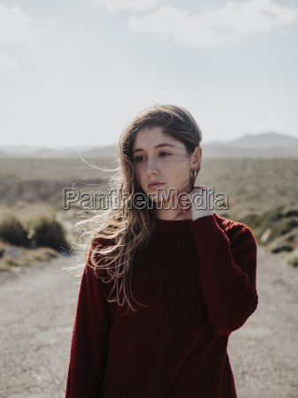woman looking away while standing on