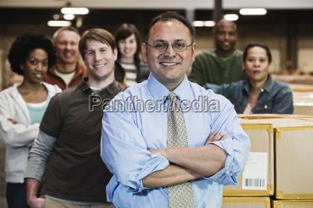 team portrait of multi ethnic warehouse