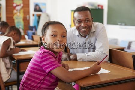 black teacher and elementary school girl