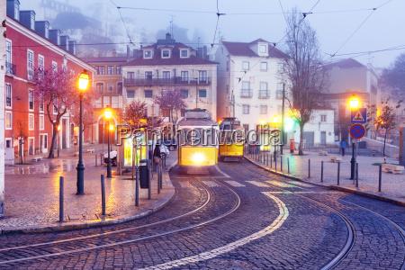 yellow 28 tram in alfama lisbon
