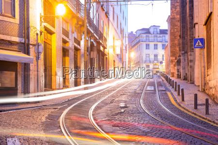 yellow 28 tram in alfama at