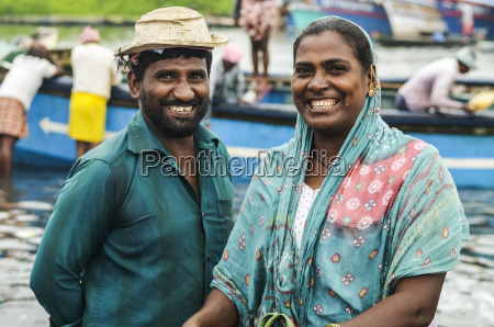 smiling man and woman in fishing