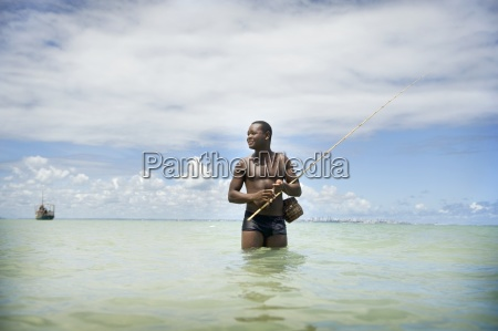 man fishing in ocean brazil