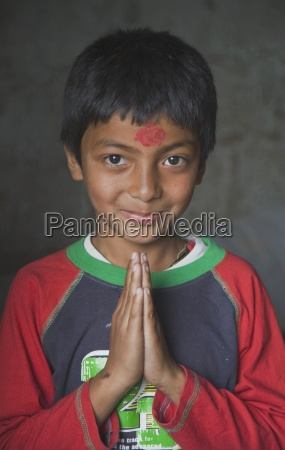 boy with hands in prayer pokhara