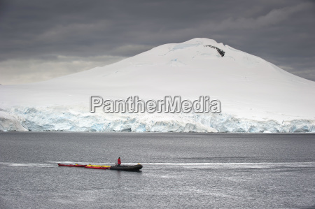 a zodiac in the water antarctic