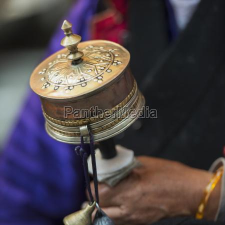 woman holding prayer wheel lhasa tibet