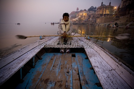 man rowing on river ganges river