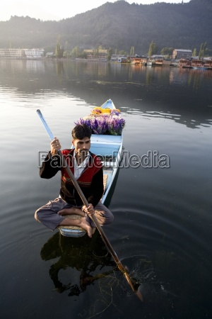 man canoeing on lake dal lake