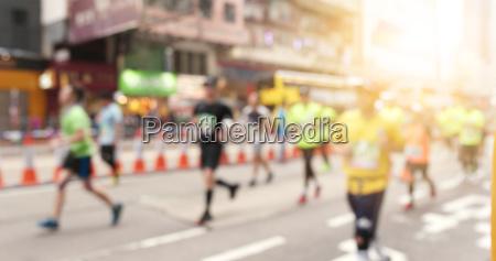 blur view of marathon in city