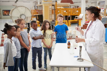lab technician with group of kids