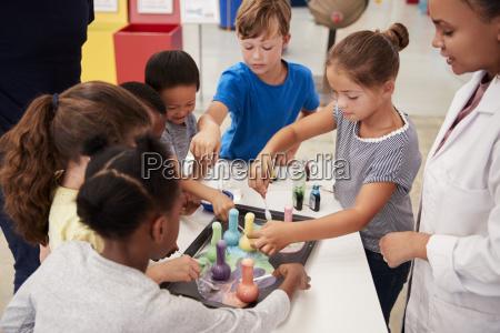 school kids taking part in experiment