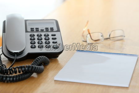 phone and note on a desk
