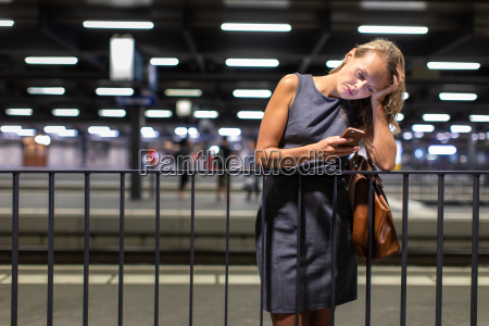 pretty young female commuter waiting for