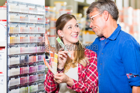 couple choosing color of paint in