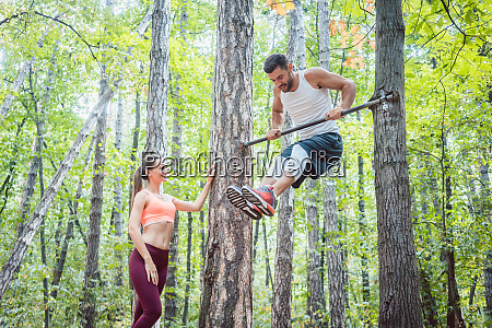 strong man and athletic woman doing