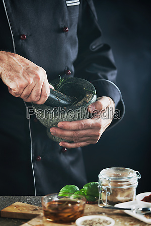male chef blending herbs in a