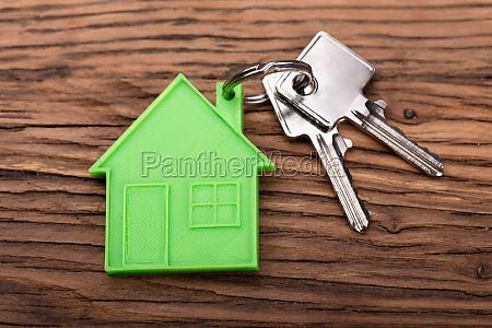 green house keychain on key