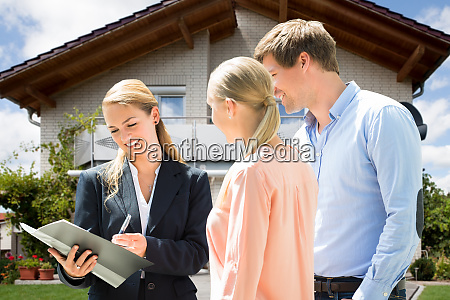real estate agent explaining contract to