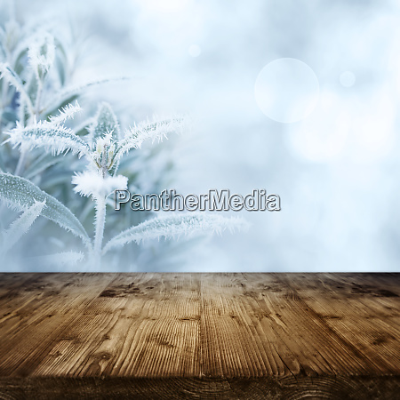 ice flowers with wooden table in