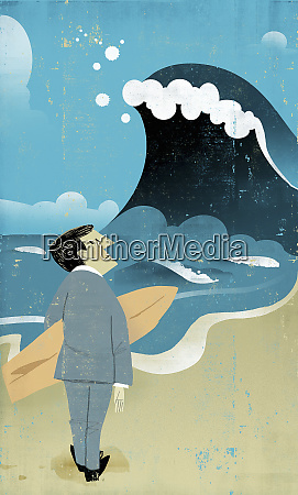 businessman holding surfboard watching large wave