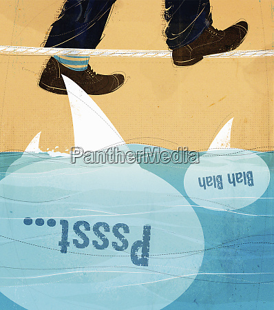 mans feet walking tightrope above shark