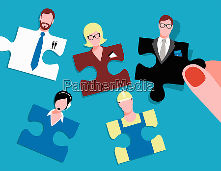 hand choosing jigsaw puzzle people with