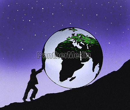businessman pushing large globe uphill