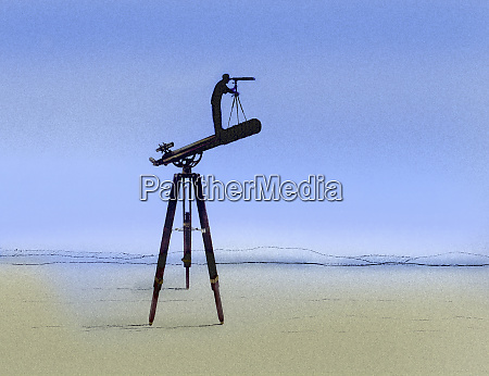 man looking through telescope standing on