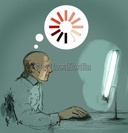 senior man using desktop computer and