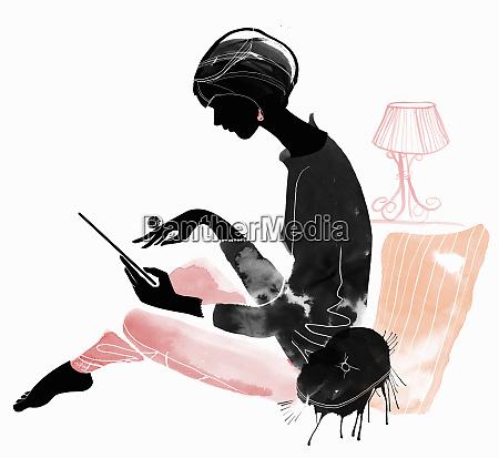 elegant woman using digital tablet in