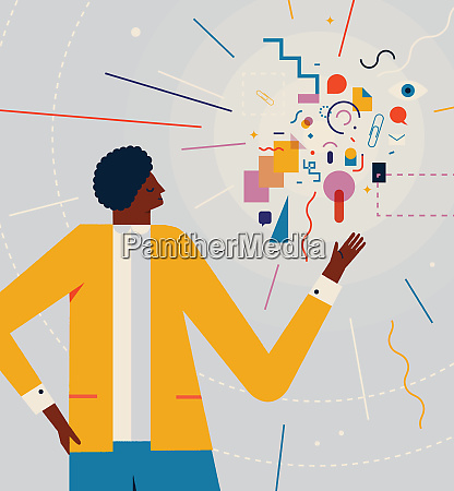 man doing presentation with colorful shapes