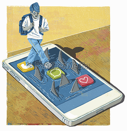 anxious schoolboy stepping on smart phone