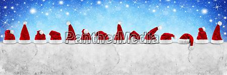fila de rojo blanco santa claus