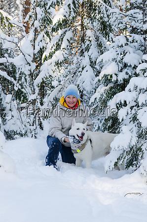 joyful woman with a white dog