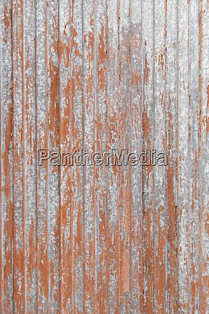 rusty red metal door