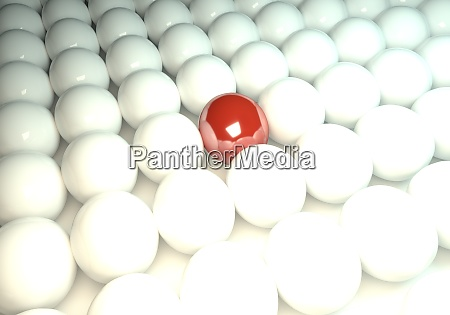 red ball in between many white