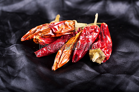 dried red hot peppers over black