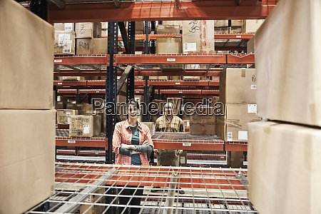 a caucasian male and female warehouse