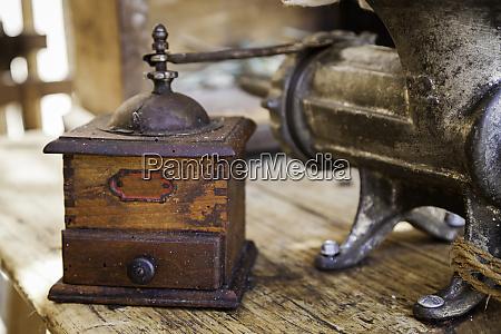 old coffee grinder made of wood
