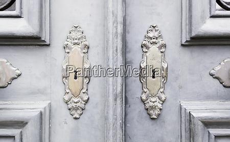 wooden door with metal knockers