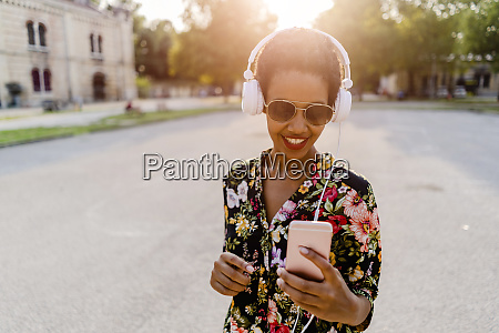 happy fashionable young woman with headphones